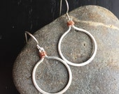 Fine silver circle hoops with copper wire accents