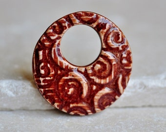 Crimson Swirl Ceramic Pendant, ceramic jewelry in porcelain clay, abstract swirl handcarved design by Artgirl56