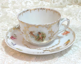 Cherub Teacup And Saucer