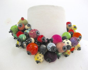 SOOO many beads. short necklace using hand painted wood beads attached to a link chain.  Very colorful.