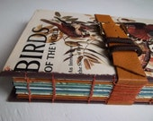 Birds Sketchbook, re-purposed vintage book with watercolor and multimedia papers, leather strap & buckle