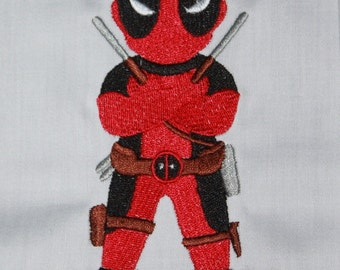 Looks like Deadpool, Wolverine, and Ant Man Machine embroidered quilt blocks