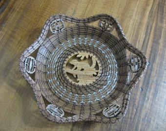 Scroll Sawn Image of a Squirrel Pine Needle Basket