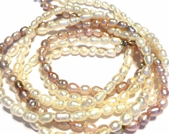 "NATURAL color Pearls fresh water rice high luster creamy mauve white and peach color 3 WHOLE 18"" strands"