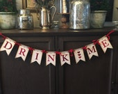 Drink Me, Eat Me or Take Me Banner. Red Glitter letters, red crinkled ribbon