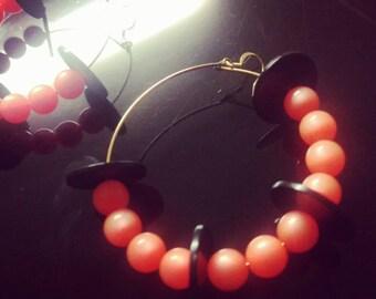 Orange and black disk hoops