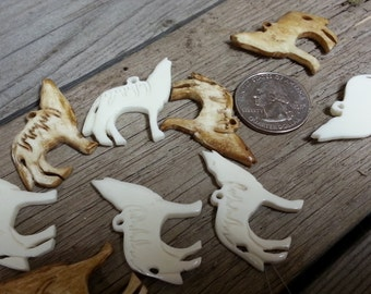 Howling Wolf Carved Bone Pendant - One Piece - Stock No. DESIGN30
