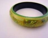 RESERVED FOR JULIE. Vintage gold, green bangle bracelet. Art deco style leaf design. Vintage jewelry. Shades of green. Large bangle bracelet
