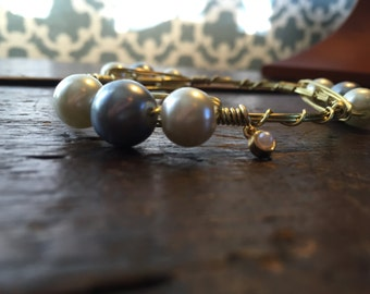 White & Black pearl gold toned wire wrapped bangle