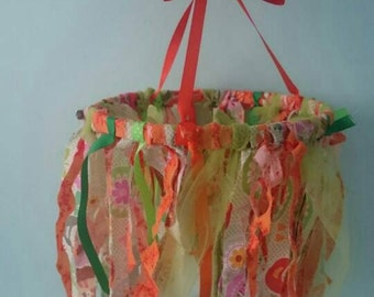 Orange and green upcycled fabric mobile / chandelier.