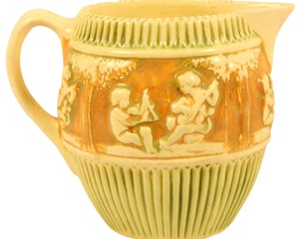 Roseville Pottery Donatello Pitcher 1307
