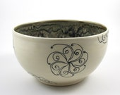 White Pottery Serving Bowl with Multicolored Glaze and Black Swirls