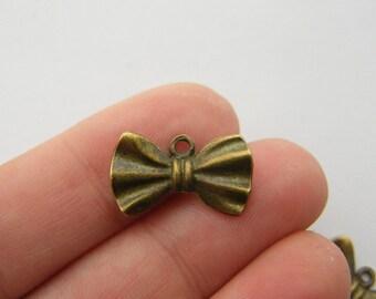 8 Bow tie charms antique bronze tone BC40