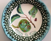 Nathalie Lete apple and caterpillar dinner plate