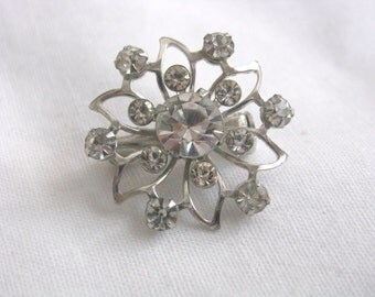Vintage metal star flower snowflake pin with rhinestones
