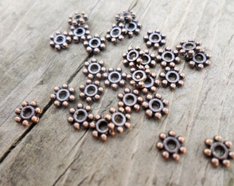 Antiqued Copper Tone Daisy Spacers 4mm 190 piece bag