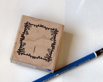Wood mounted frame stamp, used