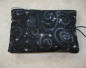 padded makeup jewelry bag in black celestial print