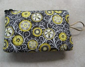 yellow and black padded makeup jewelry bag in lemon flower print