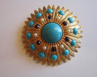 vintage brooch with bail - gold tone starburst with faux turquoise cabs and purple rhinestones - pendant brooch - 1.75 inches