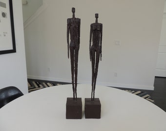 Brutalist mid century metal sculptures man women