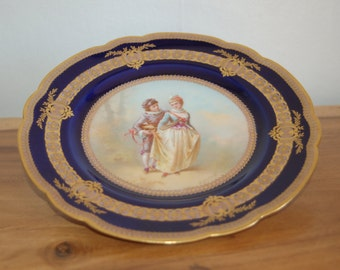 """Haviland & Co. Limoges France """"Courting Couple"""" painted by E. Furlaud on a scalloped cobalt Cabinet plate w/ raised gold gilt ~ 1900-1930"""