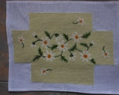 vintage finished needlepoint daiseys on a pale green background 14 by 9  inches corners clipped box?