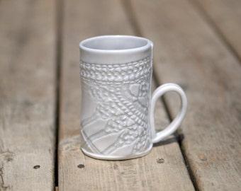 Ceramic mug in pale blue gray.  Porcelain handbuilt mug with the impression of a vintage doily.