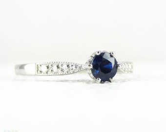 Sapphire Engagement Ring in Vintage Style Platinum Setting, 0.31 ct Round Cut Blue Sapphire in Engraved Beaded Platinum Setting.