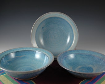 Three Light Blue Stoneware Soup / Cereal  bowls with rim by Douglas Bechler