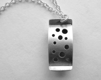 Holes in Silver Pendant oxidized sterling modern handfabricated