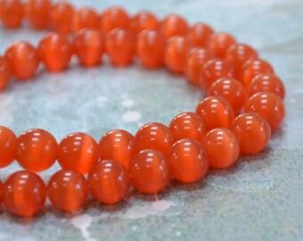 """50 Cat's Eye Glass 8mm Red Orange Round Beads Fiber Optic 16"""" Strand"""