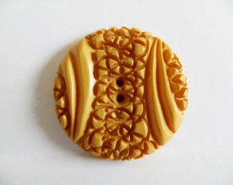 Large Custard Bakelite Button Hyper Carving