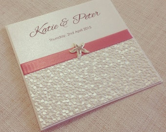 Coastal beach destination wedding invitation - SAMPLE - metallic pebble paper & shell or starfish - elegant beach wedding invitations