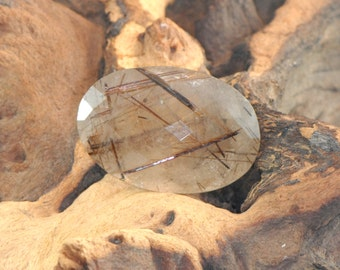 Copper Rutilated Quartz large oval faceted natural gemstone 91 cts
