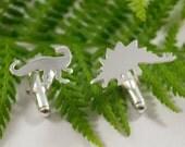 Set of 6 Silver Dinosaur cufflinks: A set of 6 dinosaur shaped sterling silver cufflinks.