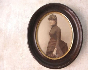 Victorian portrait of bustled woman / hand colored photograph / oval frame / decor decoration wall hanging