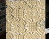 """12"""" Antique Tin Ceiling Tile -- Light Yellow Colored Paint -- Repeating Flower Pattern"""