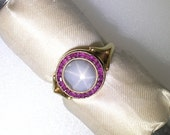 GRAYISH-Blue STAR SAPPHIRE Surrounded by Square Cut Rubies in 14k Yellow Gold