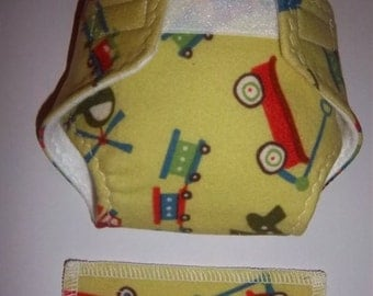Baby Doll Diaper/wipe - transportation on green  - - adjustable for many dolls such as bitty baby