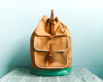 Vintage 70s canvas bag shoulder bag handbag drawstring bucket bag / hobo / washed out pale orange / canvas plastic leather
