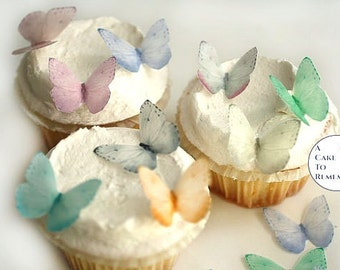 "24 small pale pastels wafer paper edible butterflies for cake and cupcake decorating. 1.25"" across, edible cupcake decorations"