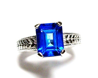 "Swiss blue topaz, birthstone ring,solitaire ring, electric blue, engagement ring,  s 6 1/2   ""Something Blue"""