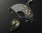 Spring flower Keum Boo silver pendant with a rutilated quartz