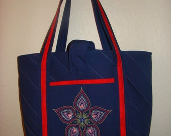 Quilted blue denim tote bag with machine embroidery.