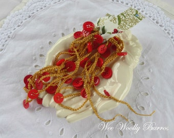 Red and Gold Crochet Button Garland by WeeWoollyBurros