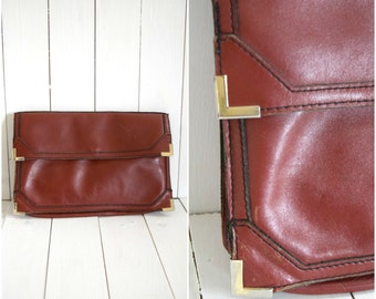 Vintage mahogany leather clutch with gold metal corners