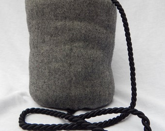 Young adult black and grey wool muff
