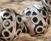 Moroccan small tarnished metal bead with circles