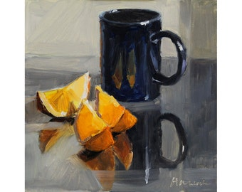 Blue Cup and Orange Slices on Mirror